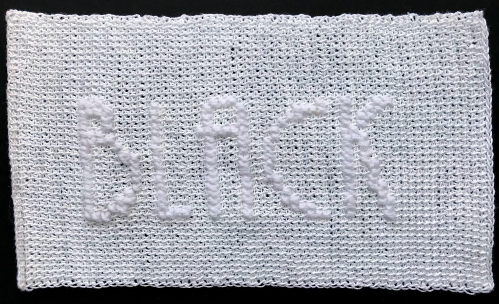 Tunisian Crochet with the work BLACK in cross stitch